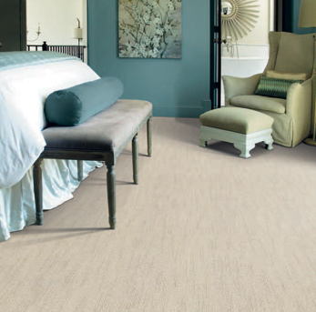 Bedroom scene with beige Infinity nylon carpet