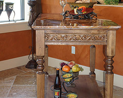 A decorative moveable island with a Onyx Marble top. We also feature Venetain Gold Travertine floor.