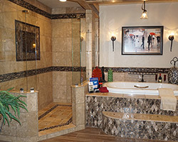 This Bain Ultra Tub is surrounded by a gorgeous mosaic, along with bubble glass on the shower floor. Bling! Bling!