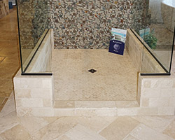 Add some interest to a shower floor with a 1x2 herringbone pattern. The slate and glass mosaic contrasts beautifully with a light travertine.