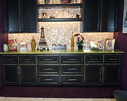 A bubble splash makes a great impression on the black and green rubbed cabinets. A one of a kind design.